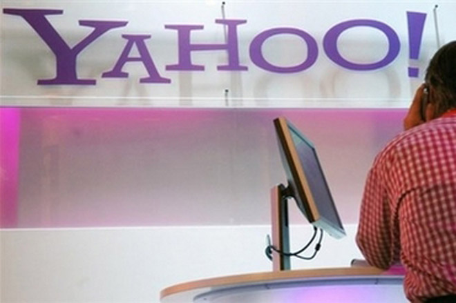 New Yahoo chief announces pregnancy as company posts lower earnings