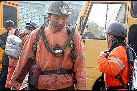 13 miners missing in flooded mines in central China