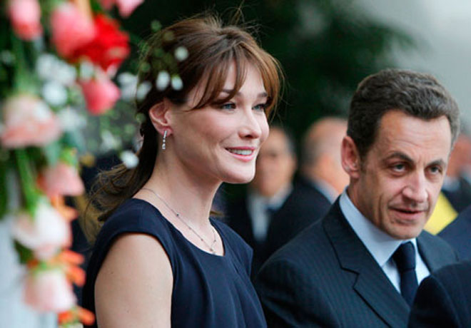 Bruni-Sarkozy seeks compensation over photos with navy wives