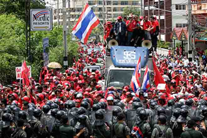 Thousands of protesters gather in Bangkok, seek polls