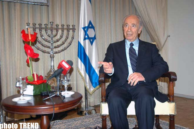Peres: World needs missile defense system against Iran