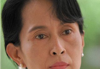 Supporters throng streets as Myanmar leader Suu Kyi returns from The Hague