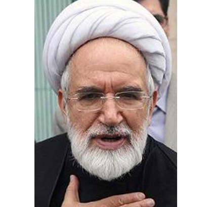 Iranian opposition leader's car hit by gunfire