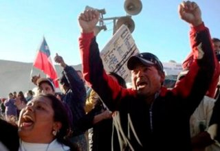 At least three dead in fires amid Chilean riots, flights out of Santiago delayed