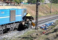 Three killed in Poland as train crashes into station