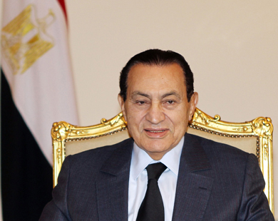 Mubarak fires ministers, appeals for calm