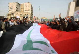 Iraqi forces push protesters back to main square, kill five