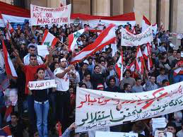 Syrians demonstrate to denounce Arab League's decision
