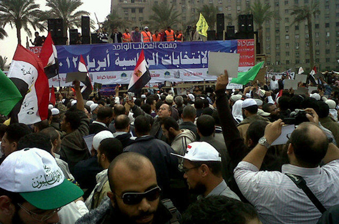 Tahrir Square erupts in cheers upon news of Sharaf government resignation