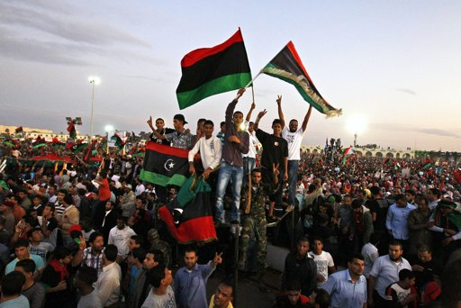 Libya bars Gaddafi loyalists from holding office after protests