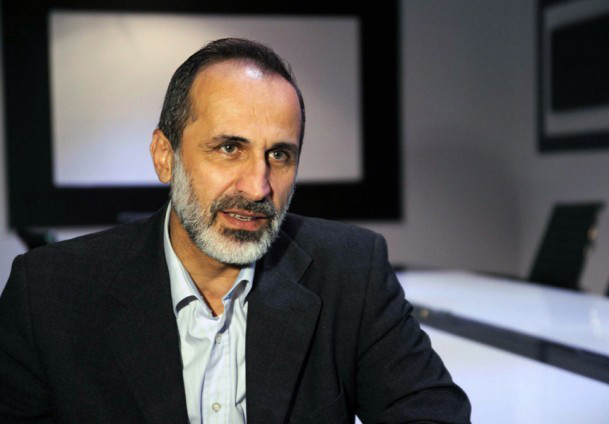 Syrian opposition chief under fire for talks with Assad allies