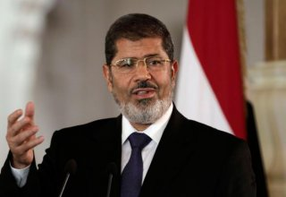 Morsi charged for passing documents to Qatar