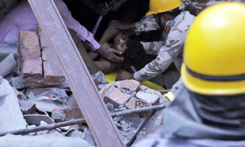 14 killed, 100 trapped after building collapses in India (UPDATED)