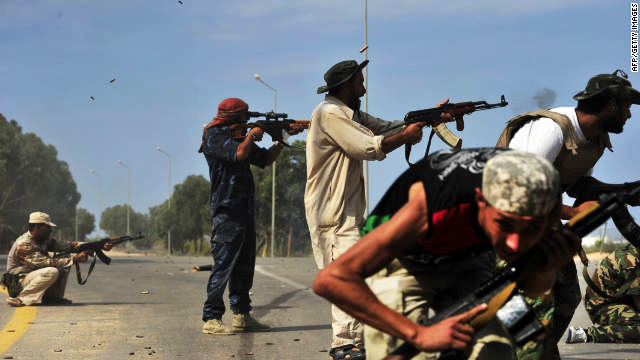 Libya fighters continue siege of ministries