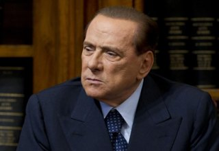 Italy's Berlusconi hospitalized but vows to resume campaign