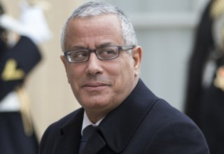 Maltese PM: Libya's ousted PM stops in Malta on way to 'another European country'