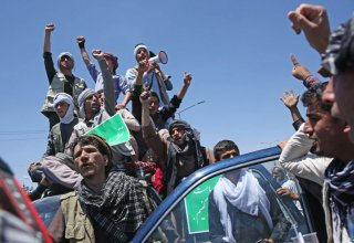 Supporters of Afghanistan's Abdullah rally after disputed vote