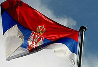 Serbia's ruling coalition achieves record election victory