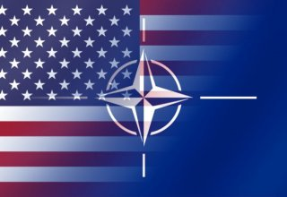 Trump reaffirms US commitment to NATO in conversation with Hollande