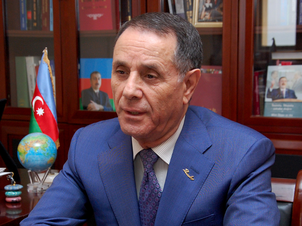 Azerbaijani top official calls on people to come together, overcome global crisis