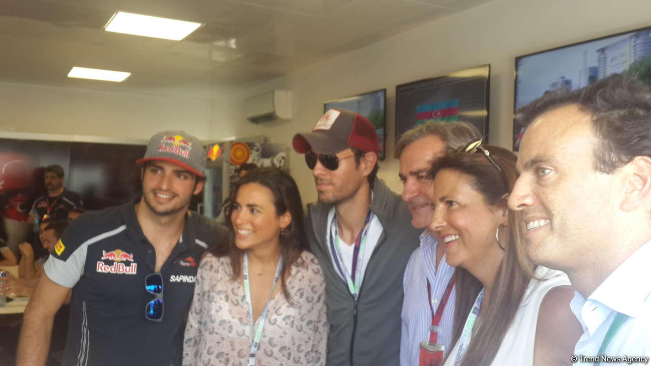 Enrique Iglesias visits pit boxes of teams participating in F1 Grand Prix of Europe in Baku