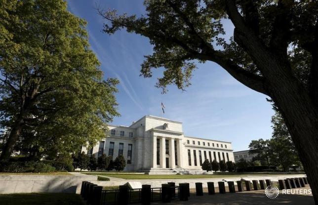 Fed raises rates, sees at least three more years of economic growth