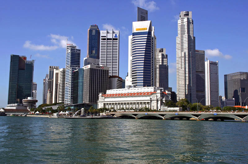 Singapore cuts 2020 GDP outlook for third time as virus batters economy