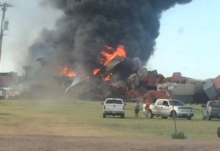 Train in Iowa hauling hazardous materials derails, catches fire