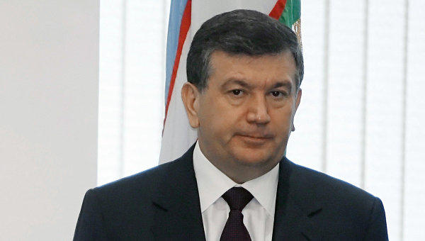 Uzbek president okays deals with Russia on labor migration co-op