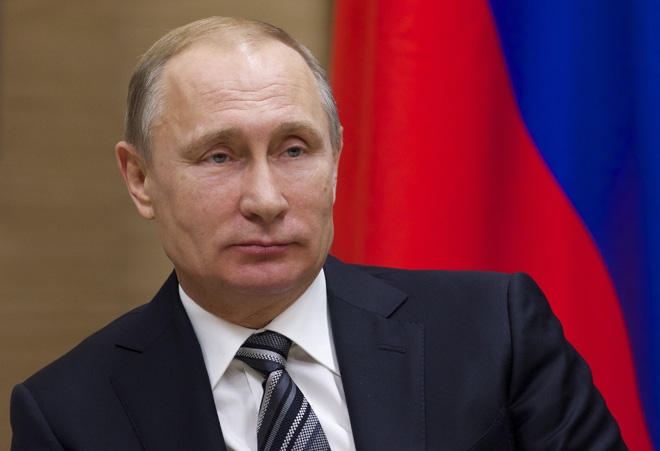 Putin says adheres to constitution, no more than two presidential terms in row