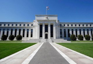 Fed raises interest rates, sees 'some further' hikes ahead