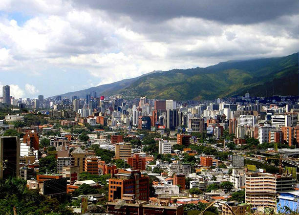 Venezuela to let companies raise capital in dollars as Maduro liberalizes economy