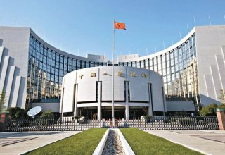 China central bank will back growth, watch debt risks