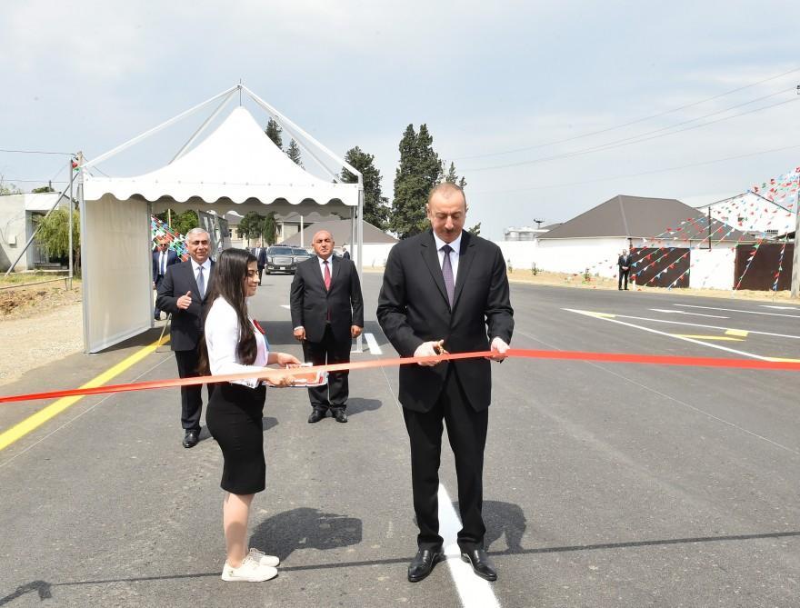 Президент Ильхам Алиев принял участие в открытии автодороги Делимамедли-Муздурлар-Гырыглы в Геранбойском районе (ФОТО) - Gallery Image