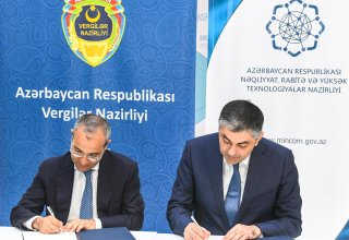 Azerbaijan's ministries of communications and taxes sign protocols of agreement (PHOTO)