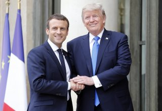 Macron plays down Trump absence at G7 climate talks