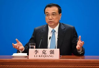 China's premier says will continue implementing tax, fee cuts