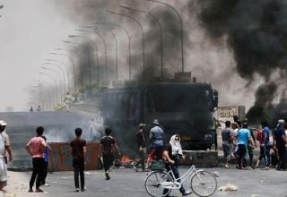Iraqi forces shoot three dead in southern city as protests flare