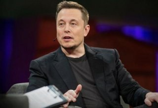 Tesla CEO says he is open to friendly deal with rival carmaker