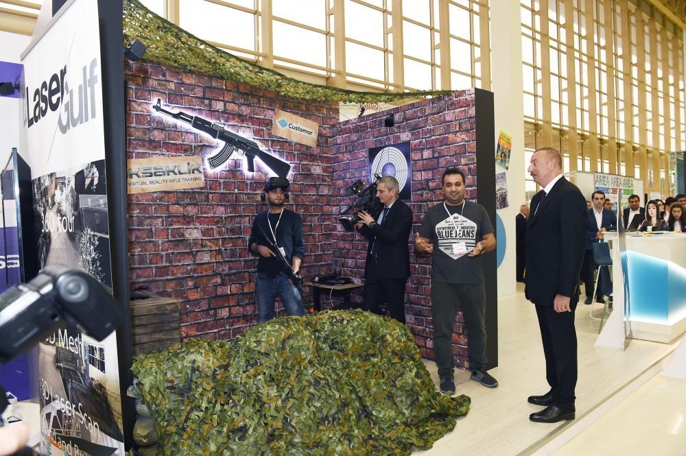 Президент Ильхам Алиев и Первая леди Мехрибан Алиева ознакомились с выставкой «Bakutel-2018» (ФОТО) - Gallery Image