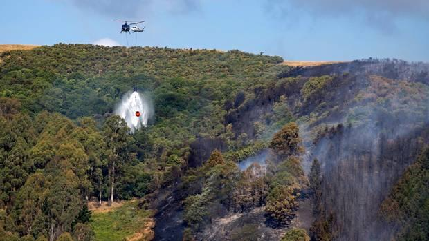 Helicopter crashes while fighting fires in New Zealand's south island