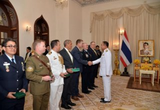 Thai king confers awards on two Australian divers for rescue of cave boys