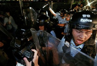 Clashes as police try to clear Hong Kong protesters after Uighur support rally