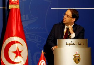 Tunisian PM bans face veils in public institutions after bombing