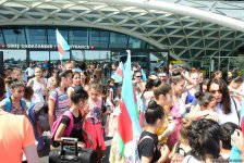 Victorious Azerbaijani gymnast returns home from FIG Championships in Moscow (PHOTO) - Gallery Thumbnail