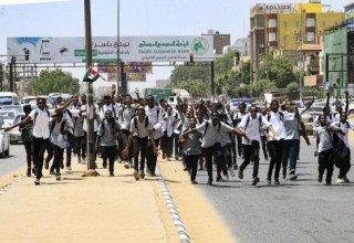 Sudan army commander says bank security force killed protesting children