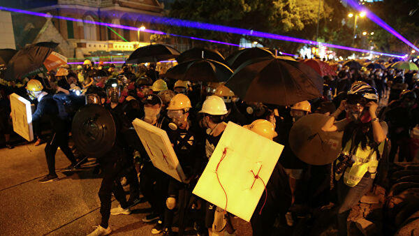 Hong Kong police arrest 36 people after running battles with protesters