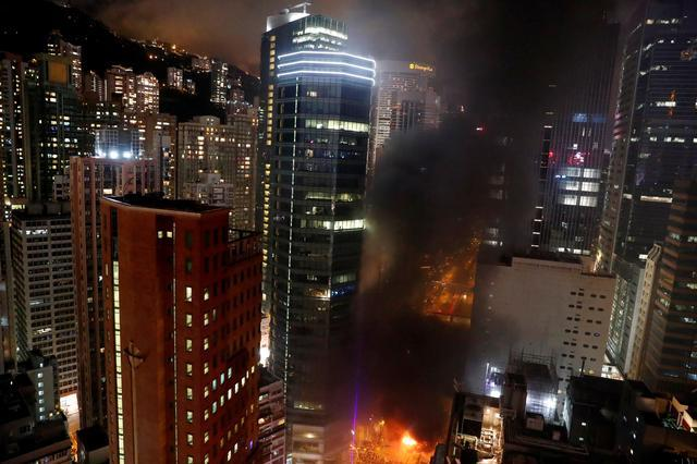 Hong Kong commercial centers paralyzed as protesters, police exchange petrol bombs and tear gas