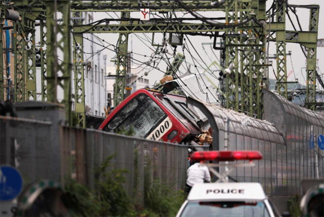 At least 30 injured after collision of train and truck in Japan's Yokohama