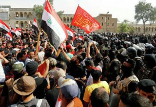 Protesters outside U.S. Baghdad embassy condemn air strikes